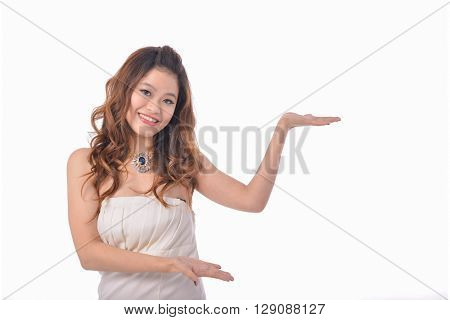 photo of young woman in white dress with hand gesture