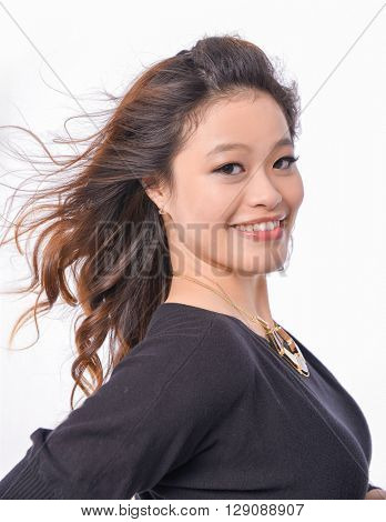 Portrait of smile young woman posing in studio