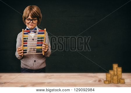 Pupil holding abacus against green