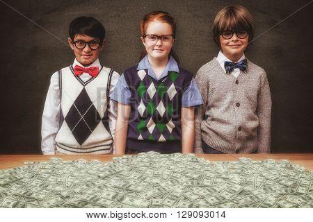 Cute pupils against blackboard