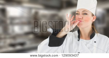 Portrait of a woman chef satisfying against a cooker