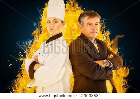 Portrait of chef and businessman back to back against blue background with vignette