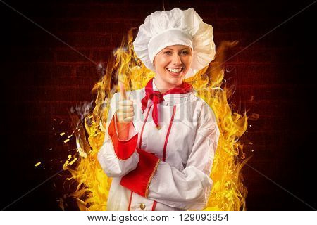Pretty chef showing thumbs up against red background with vignette