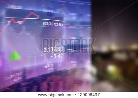 Stocks and shares against cityscape by night