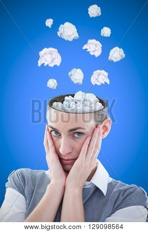 Business team thinking against blue background