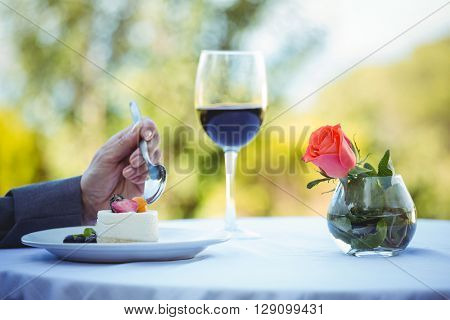 Businesswoman having a desert on a restaurant terrace
