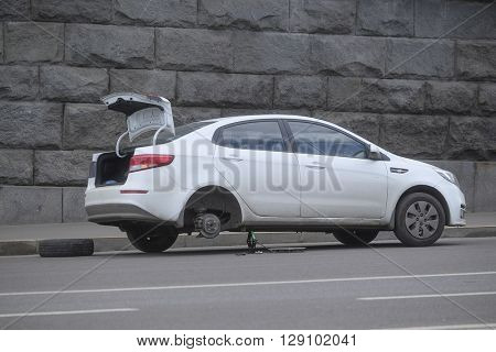 Moscow, Russia - May, 6, 2016: the broken car costs without wheel in the center of Moscow, Russia