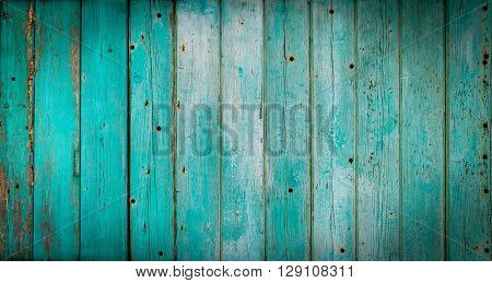 Texture Of Vertical Wooden Planks With Peeling Turquoise Blue Color Paint. Detailed Background Photo