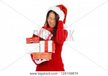 Woman in christmas attire holding pile of gifts on white background