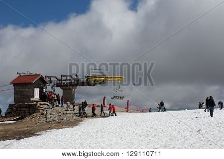 SERRA DA ESTRELA, PORTUGAL - APRIL 24, 2016: People on the mountain ski resort in Serra da Estrela. Serra da Estrela is the only ski resort in Portugal, in April 2016. Serra da Estrela, Portugal