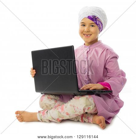 Little muslim girl with laptop isolated