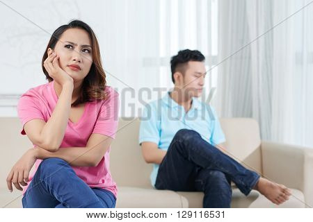 Portrait of unhappy pensive girl after quarrel with her boyfriend