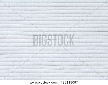 Off-white ribbed knitted cotton fabric cool weather background