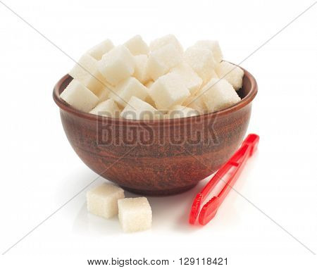 sugar cubes in bowl isolated on white background