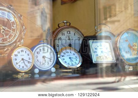 TIMISOARA, ROMANIA - JULY 29, 2015: old russian alarm clocks SLAVA and ANKER made in West Germany in a showcase of Timisoara downtown