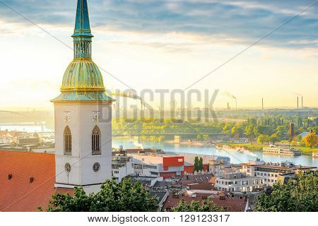 St. Martin's church tower on the foggy morning with industrial district on the background in Bratislava, Slovakia