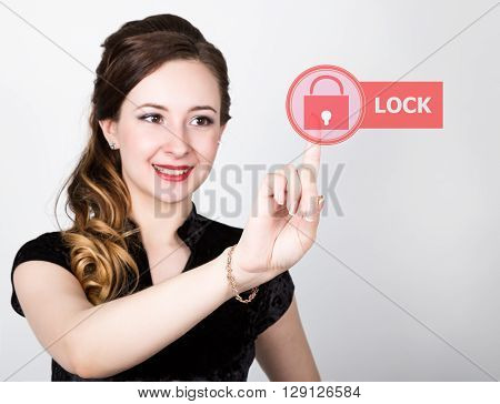 technology, internet and networking concept. beautiful woman in a black business shirt. woman presses lock button on virtual screens