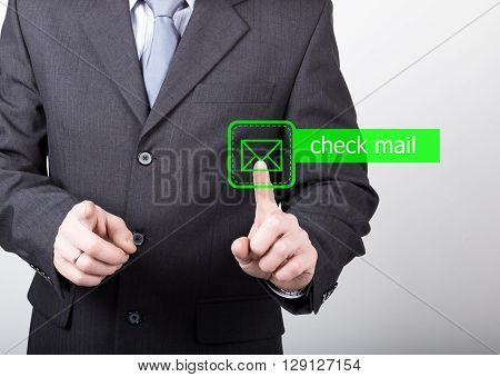 technology, internet and networking concept. man in a black business shirt. man presses check mail button on virtual screens.