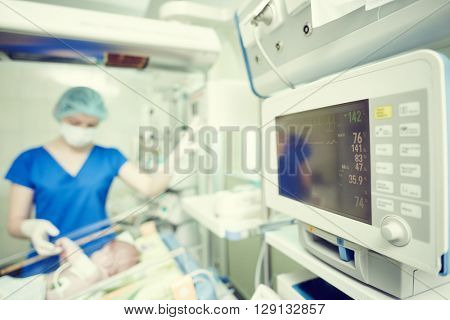 intensive care unit female doctor with baby infant