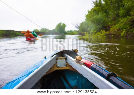 Red paddle and little snail are on kayak