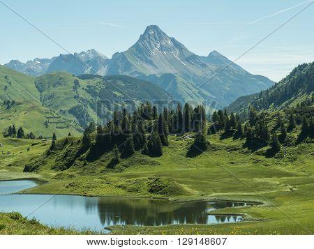 A view of the Kalbelesee lake surrounded by the Alpine mountains near village Schroecken in Bregenzerwald region Vorarlberg Austria
