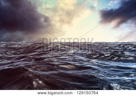 Blue rough ocean against cloudy sky