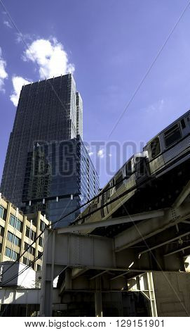 Train going through Chicago with Blue Sky.