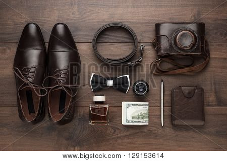 men's accessories in oder on the brown wooden table overhead view
