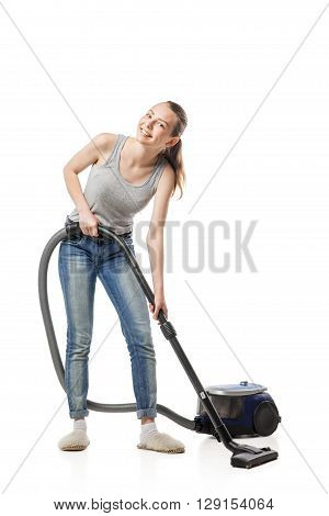 Smiling young woman with vacuum-cleaner, housewife, isolated on white poster