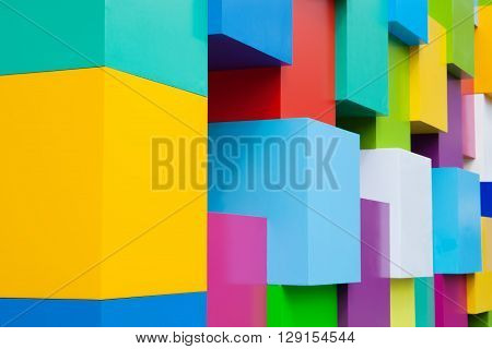 Abstract colorful architectural objects. Yellow red green blue pink, white colored blocks. Pantone colors