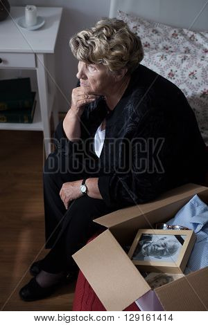 Grandmother with box of keepsakes of her lost husband