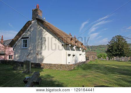 A Devon Cottage in a rural village next to the village churchyard