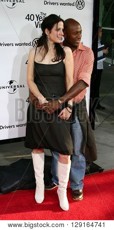 """Mary-Louise Parker and Romany Malco at the Los Angeles premiere of """"The 40 Year-Old Virgin"""" held at the ArcLight Theatre in Hollywood, USA on August 11, 2005."""