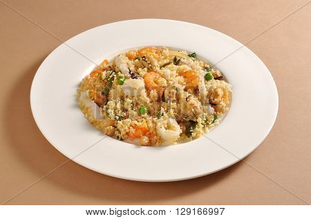 Dish with portion of cous cous and fish