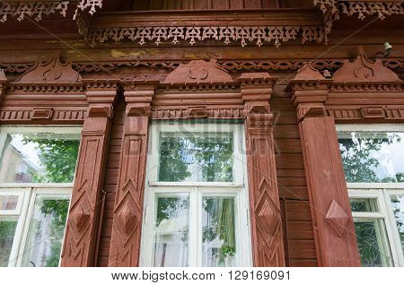 GOMEL BELARUS - MAY 1 2016: Fragment of wooden building of the 19th - early 20th centuries Paris Commune Street 12 Gomel Belarus