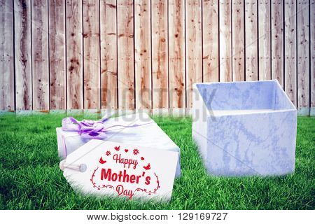 mothers day greeting against wooden background in pale wood