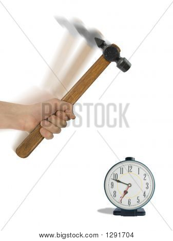 Alarm Clock And Hammer In Hand