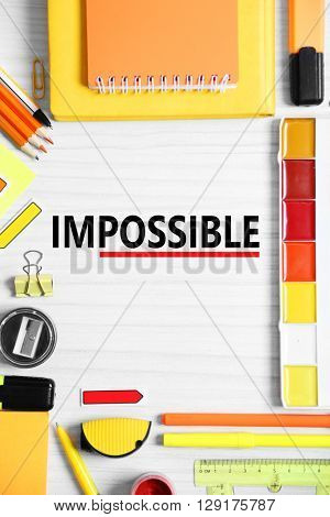 Word impossible transformed into possible and school supplies