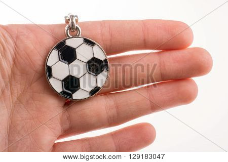 Football shaped keyholder in hand on a white background