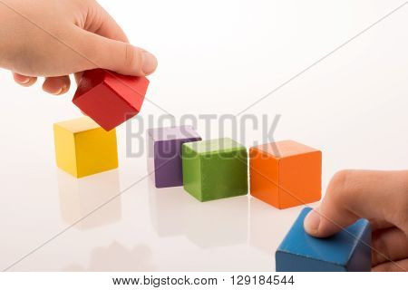 Hand Playing With Cubes