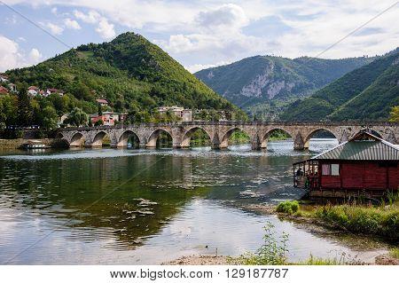 VISEGRAD BOSNIA AND HERZEGOVINA - SEPTEMEBER 4 2009: Mehmed Pasa Sokolovic bridge constructed between 1571 and 1577 by architect and engineer Mimar Sinan.