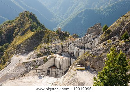 Marble Mine - Working marble mine in the Italian Alps near Carrara in Tuscany in Italy. Birds eye view. Carrara marble is widely recognized for its superior quality.