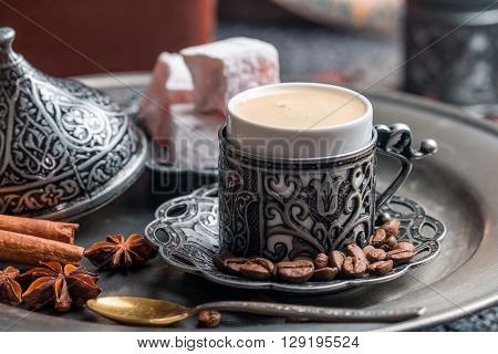 Turkish coffee and turkish delight with traditional embossed metal cup