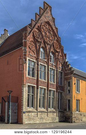 historic house with brick incised pediment in Leuven Belgium