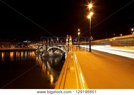 Picture of the Margaret bridge at night in Budapest Hungary