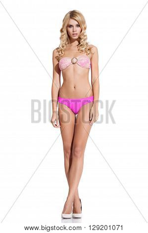 Young woman in bikini posing on white background in bikini