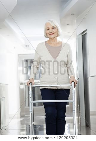 Senior Woman Using Walker At Rehab Center