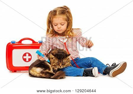Cat getting a vaccine by little girl vet isolated on white background.