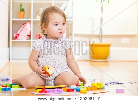 Toddler Girl Playing With Her Tablet Computer