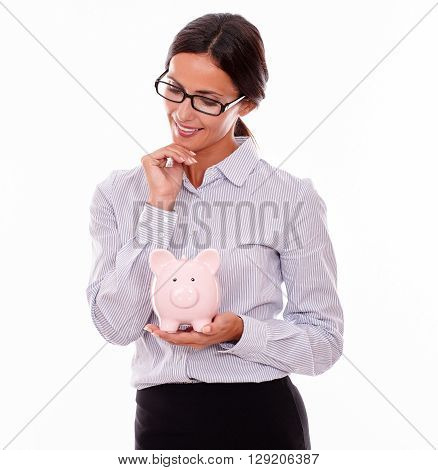 Thinking Businesswoman With Pink Piggy Bank